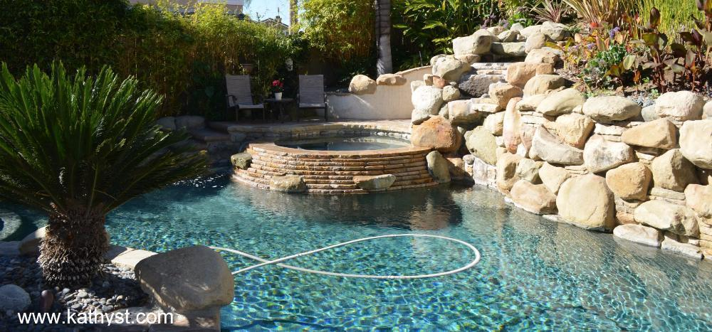 View Of A Pool Backyard With Waterfall in Camarillo